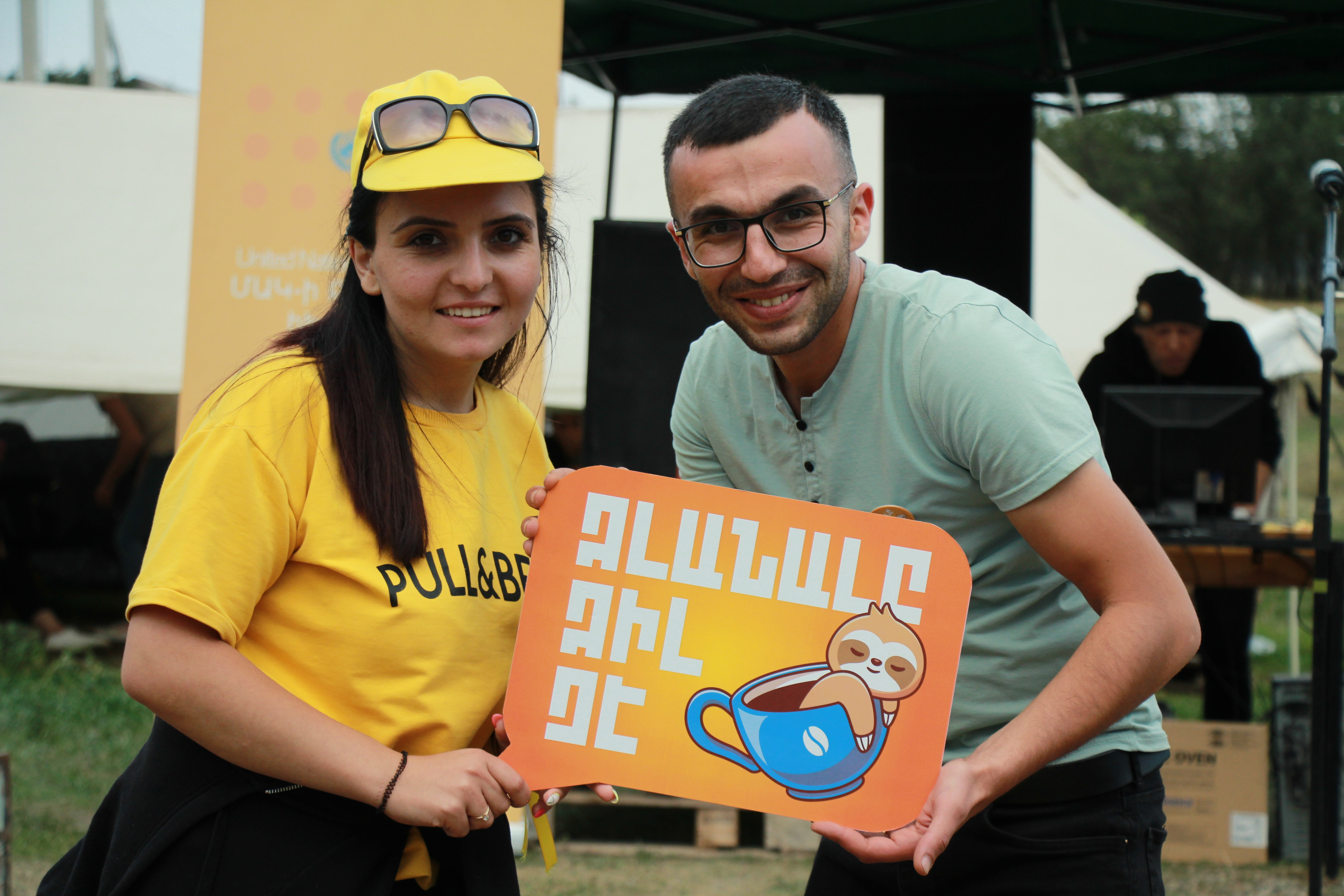"""Participants of Youth Day in Lori holding the title of the celebrations saying """"Idleness is not cool""""."""