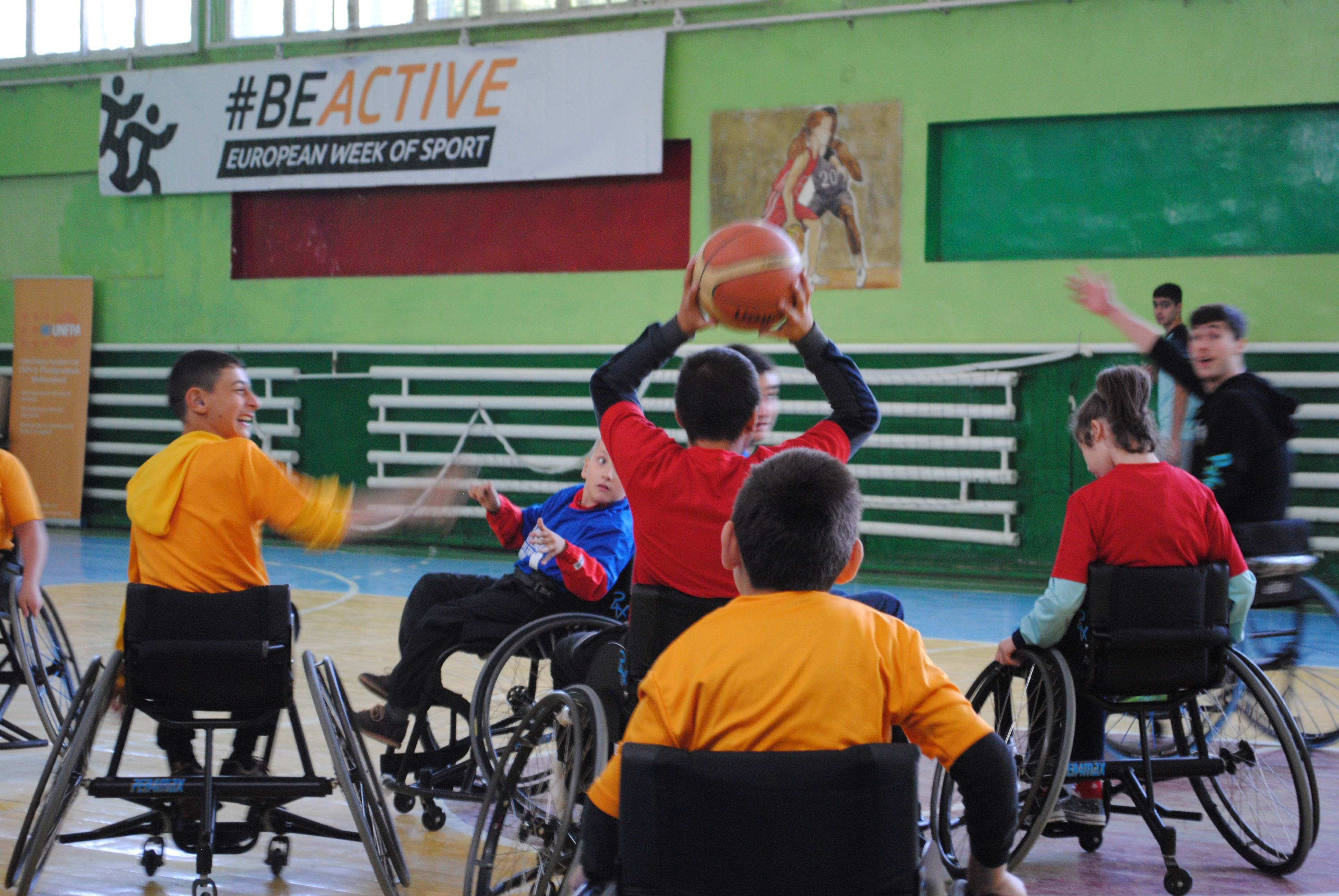"""Children and young people from """"Motus Vita"""" wheelchair basketball perform a demonstration game."""